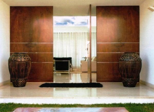porta de entrada de madeira com painel assim eu gosto