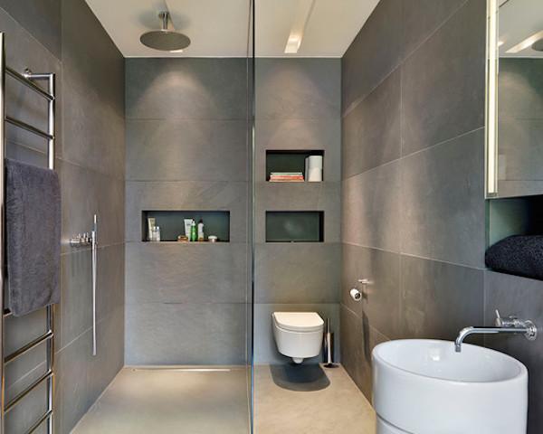 banheiros escuros parede porcelanato fosco vaso suspenso