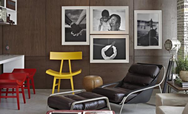 parede madeira composicao quadros poltrona couro cadeira amarela vermelha