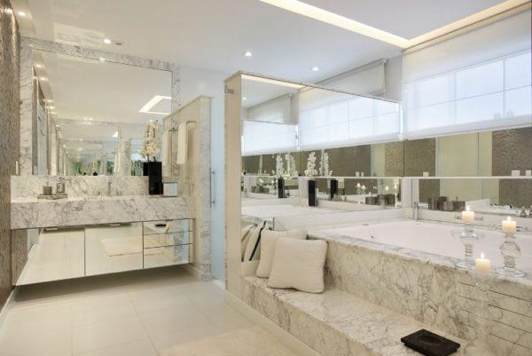 banheiro grande iluminacao rasgo banheira marmore carrara gioia