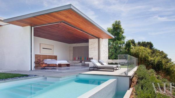 casa contemporanea com quarto aberto pra piscina